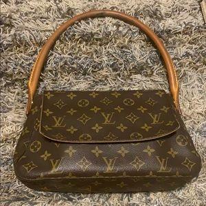 Authentic Louis Vuitton mini looping bag